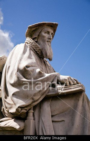 Statue of Richard Hooker in front of the Cathedral, Exeter, Devon, England stockphoto by John Rocha