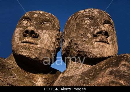 Detail of a wooden sculpture in Herne Bay featuring a couple - stock photo by John Rocha