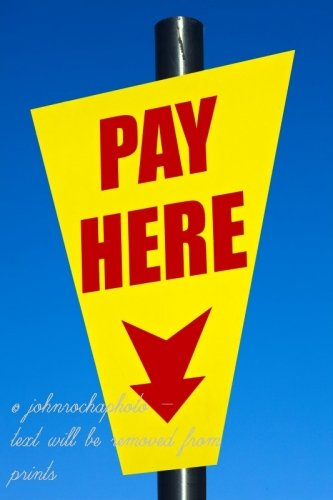 A Car park sign saying Pay Here in England