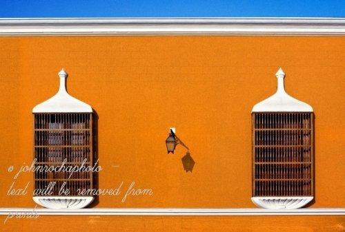 Windows of the reserve bank in Trujillo, Peru stock photo by John Rocha