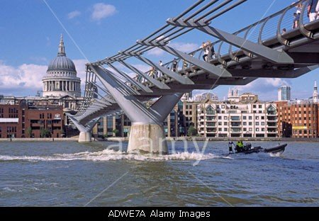 St Pauls Cathedral Contrasts With The New Millennium Bridge In London The Capital England stockphoto by john rocha at johnrochaphoto.net