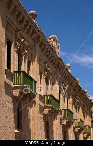Green balconies overlooking a street in Valletta the capital of Malta