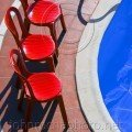 Red Chairs at the Poolside Thassos